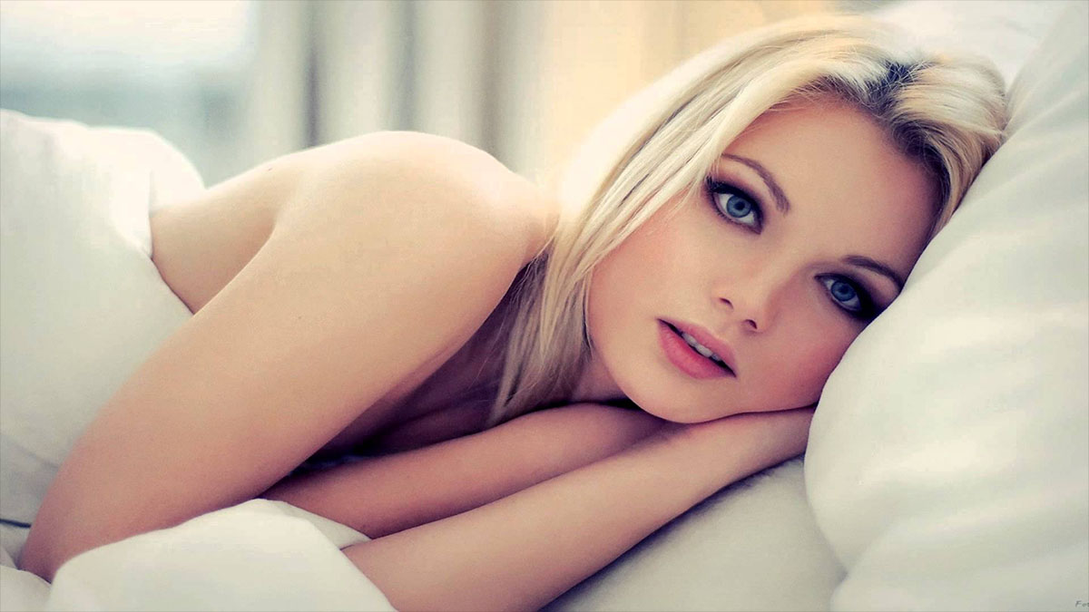 blonde model in bed