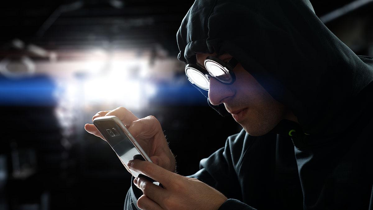 hacker with smartphone
