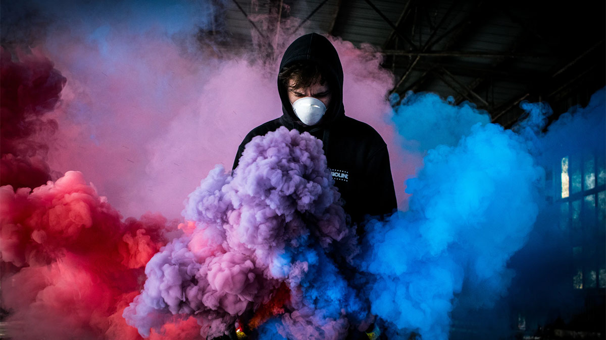 man in mask colorful smoke