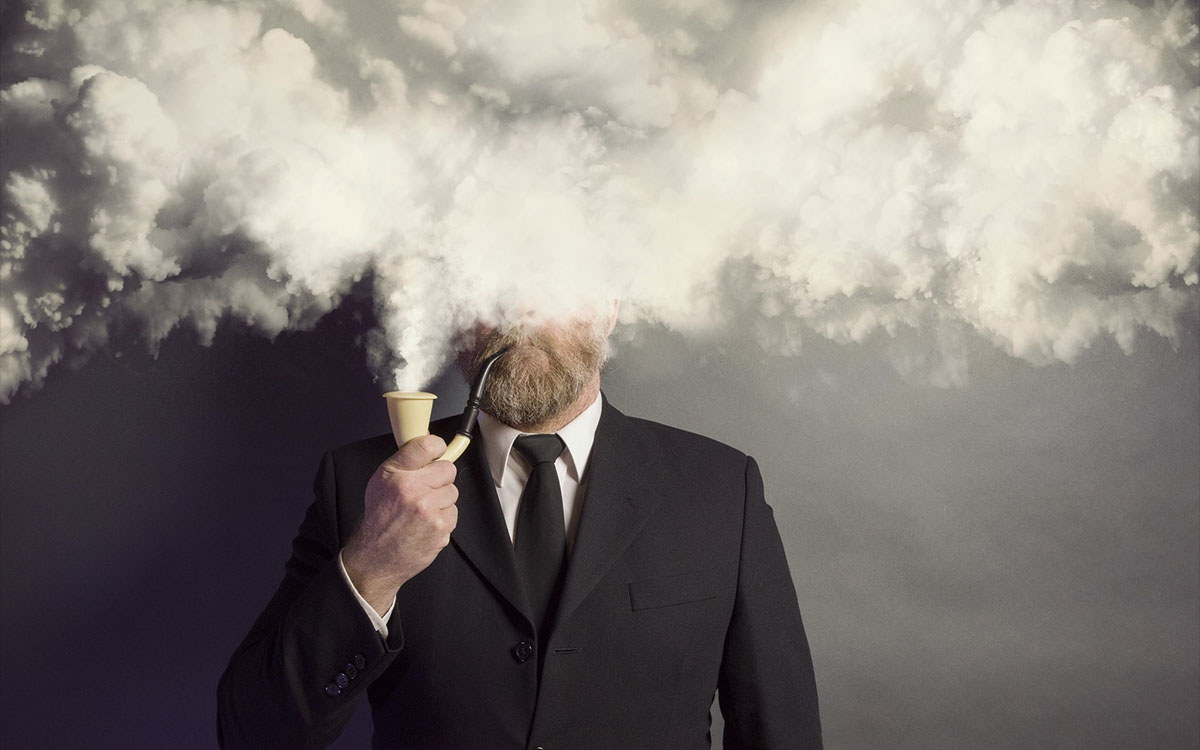 man in suit covered by smoke