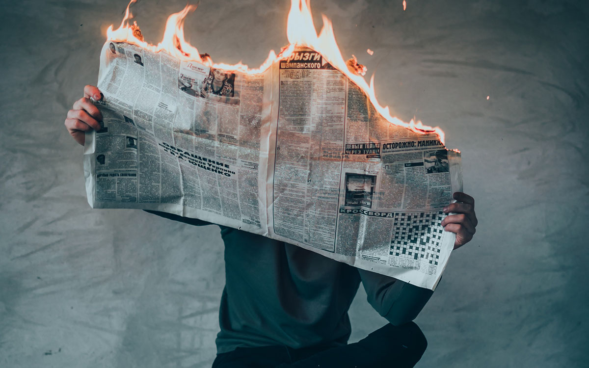 newspaper on fire