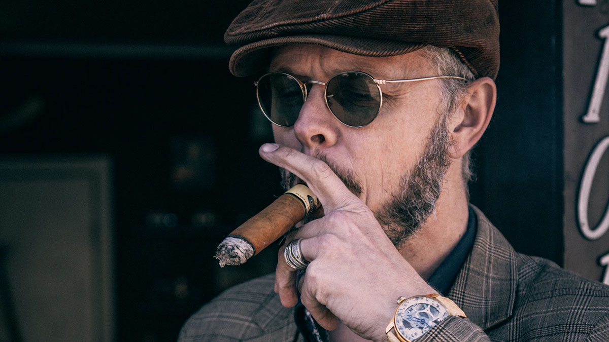 wealthy man smoking cigar