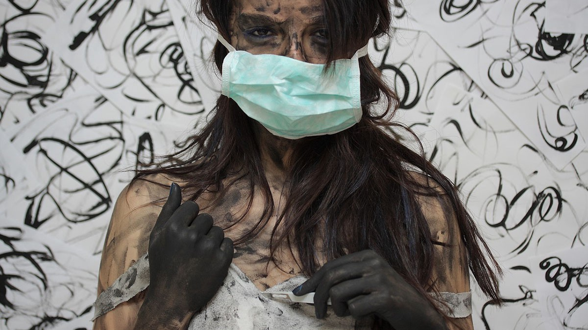 woman covered in soot